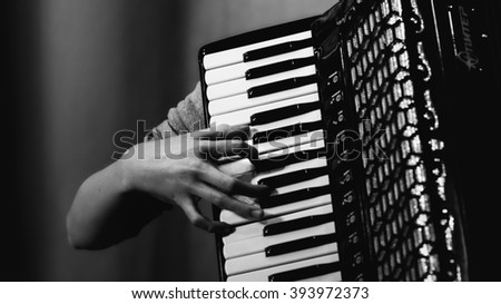A man playing the accordion - stock photo