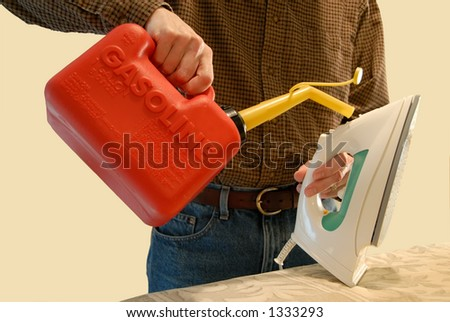 A man pouring gasoline into his clothes iron from a gas can.  Humorous concept image. - stock photo
