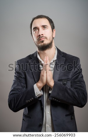 A man prays - stock photo