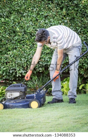 A man preparing for lawn mowing - stock photo