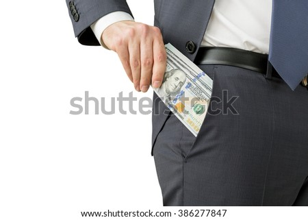 A man putting a one hundred dollar banknote into the chest pocket. Only trousers seen. Isolated. Concept of earning money. - stock photo