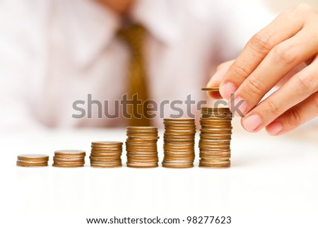 a man rising coins - stock photo