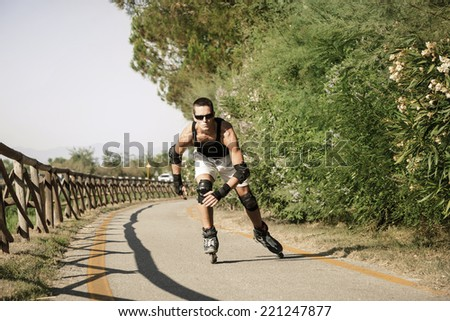 A man rollerblading outdoor. - stock photo