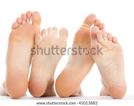 A man 's and a woman 's feet in an abstract composition, expressing love, friendship, a warm relationship isolated on white. - stock photo