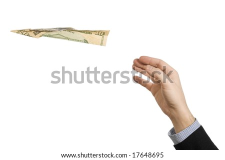 A man's hand throwing a paper plane made of a ten dollar bill. - stock photo