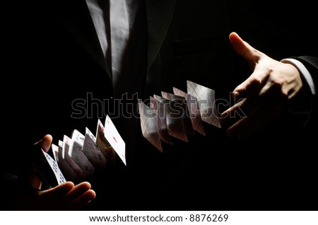 A man showing a playing-card trick - stock photo