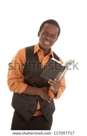 A man showing off his confused expression on his face while he is reading a book. - stock photo