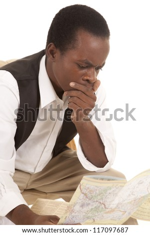 A man sitting and looking at a map with a shocked or confused expression on his face - stock photo