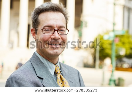 A man smiling at viewer. - stock photo