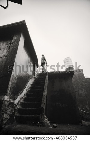 A man standing alone  - stock photo