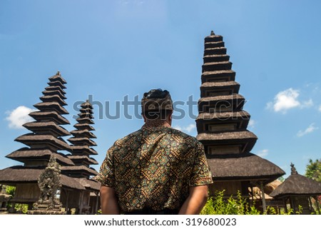 A man standing and looking to Taman Ayun temple where located in Bali, Indonesia - stock photo