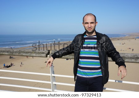 A man standing by the beach in Holland - stock photo