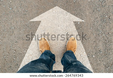 a man standing on the road. the road arrow - stock photo