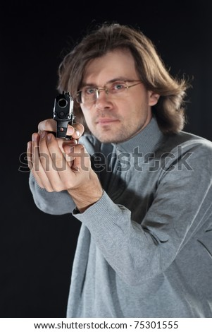 A man tacking aim. Shallow DOF. - stock photo