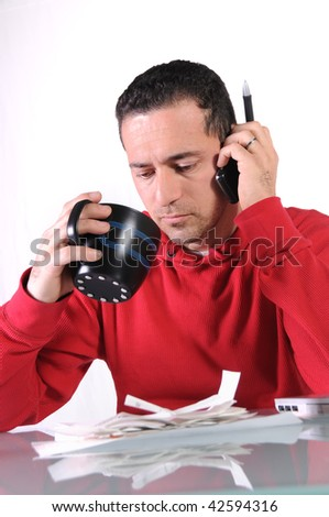 a man talking on his phone while drinking a cup of coffee - stock photo