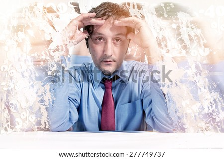 A man under stress due to finances - stock photo