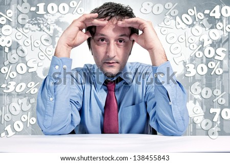 A man under stress due to finances. Selective focus on the male head - stock photo