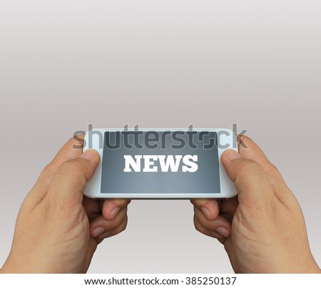 a man using hand holding the smartphone with text News on display - stock photo