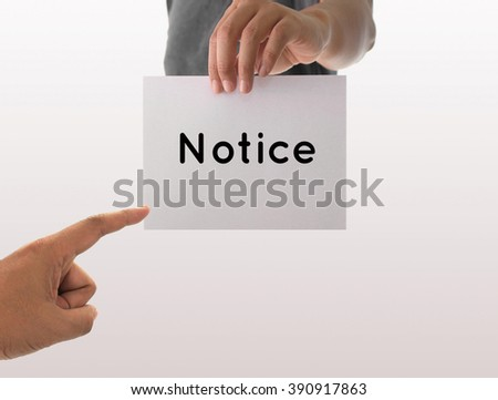a man using hand holding the white paper with text notice - stock photo