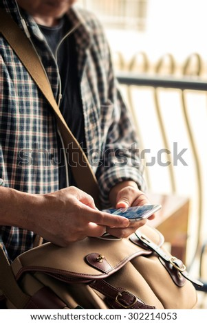 a man using mobile smart phone - stock photo