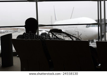 A man waiting of flight in a airport - stock photo