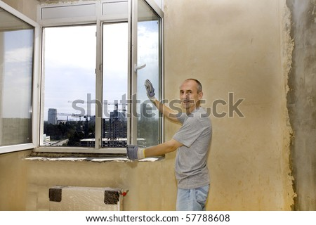 a man washing windows in a new apartment - stock photo