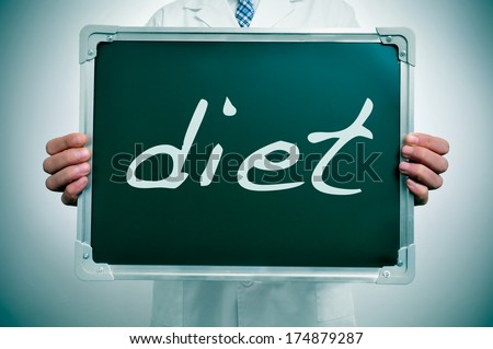 a man wearing a white coat showing a chalkboard with the word diet written in it - stock photo