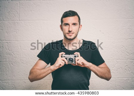 A man with a camera - stock photo