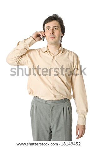 A man with a cellphone listening to something - stock photo