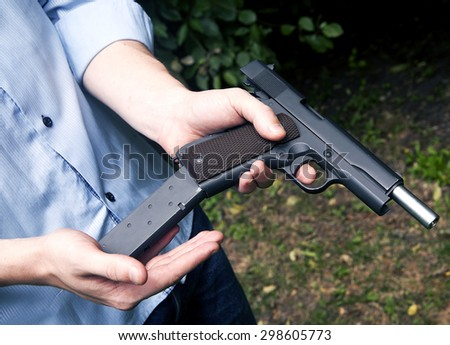 a man with a gun - stock photo