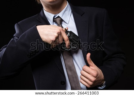 a man with a gun in studio. weapons, crime. businessman with a gun - stock photo