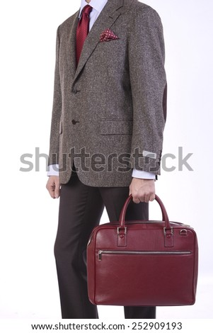 A man with a handbags in his hand - stock photo