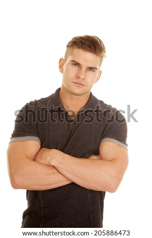 a man with a serious expression on his face with his arms folded. - stock photo