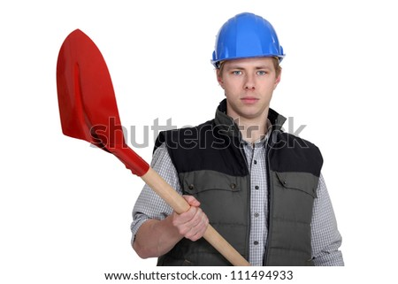 A man with a shovel. - stock photo