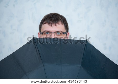 A man with an umbrella. Emotions - stock photo