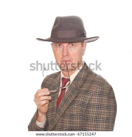 A man with eyeglasses in suit and hat isolated on white. - stock photo