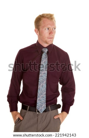 A man with his hands in his pockets looking to the side - stock photo