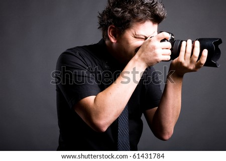 a man with photo camera - stock photo