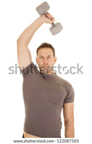 A man working out with a weight over his head working on his tricepts. - stock photo