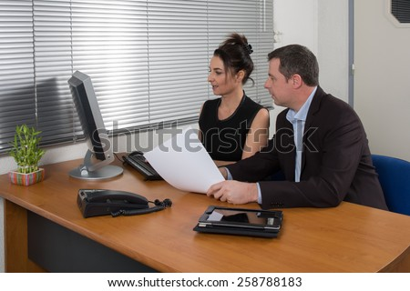 a manager  and  his secretary a  business team - stock photo