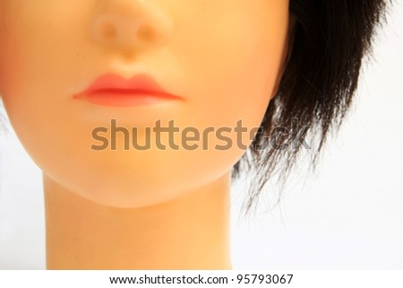 A mannequin head on a white background - stock photo
