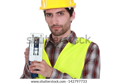 A manual worker with a jigsaw. - stock photo