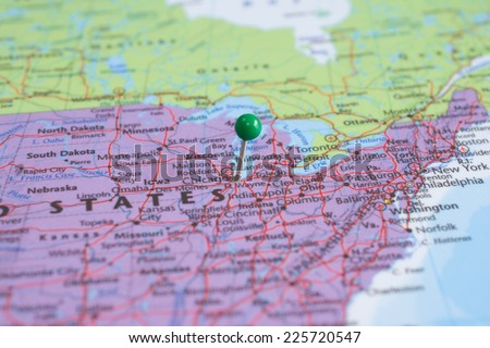 A map pin with a green head, placed at Chicago, IL on a map.  - stock photo