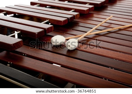 A marimba on white with mallets and copy space - stock photo