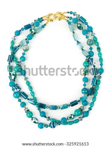 A marine style turquoise calaite necklace on white background. - stock photo
