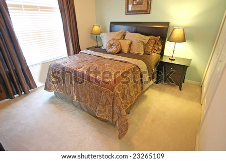 A Master Bedroom, interior shot in a home. - stock photo