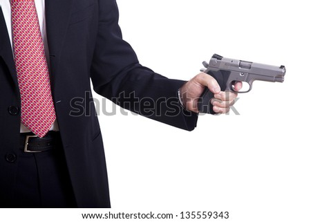 A mature adult man wearing a suit, holding a 9mm gun with both hands aiming it to the target. Isolated on white background. - stock photo