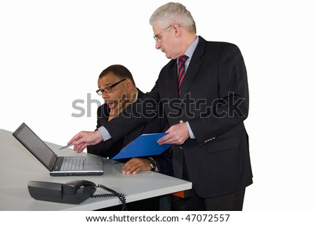 a mature African-American businessman having made a mistake and being advised by his boss, a caucasian senior manager, isolated on white background - stock photo