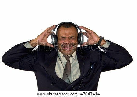 a mature African-American with headphones listening to bad sound and making faces, isolated on white background - stock photo
