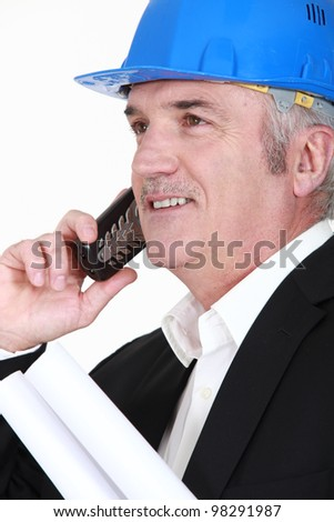A mature architect over the phone. - stock photo